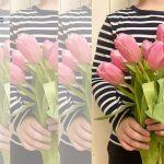 bukiet tulipanów trzymany przez dziecko
